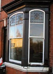 2 over 1 bay window- Arched & Stained Glass.