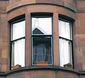 False Bowed Sash Window - Flat Glass, flat sash frames (not bow shaped).