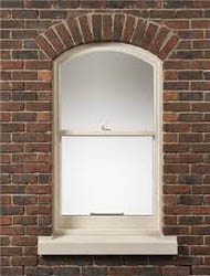 Arched head sash window.