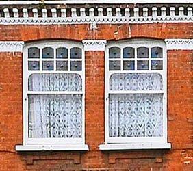 Castellated sash window style.
