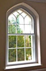 Gothic arch sash window.