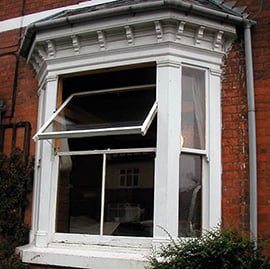 wooden sash window converted to pivot.