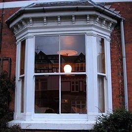 Wooden sash window reinstated to original.