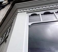 timber sash window castellated double glazed sash.