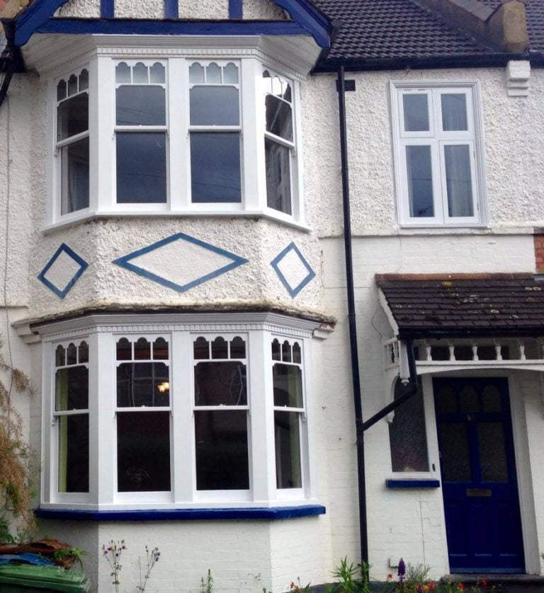 Double glazed wooden sash windows with a castellated glazing