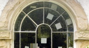 Replacing Glass in an arched window = Manchester sash window specialist