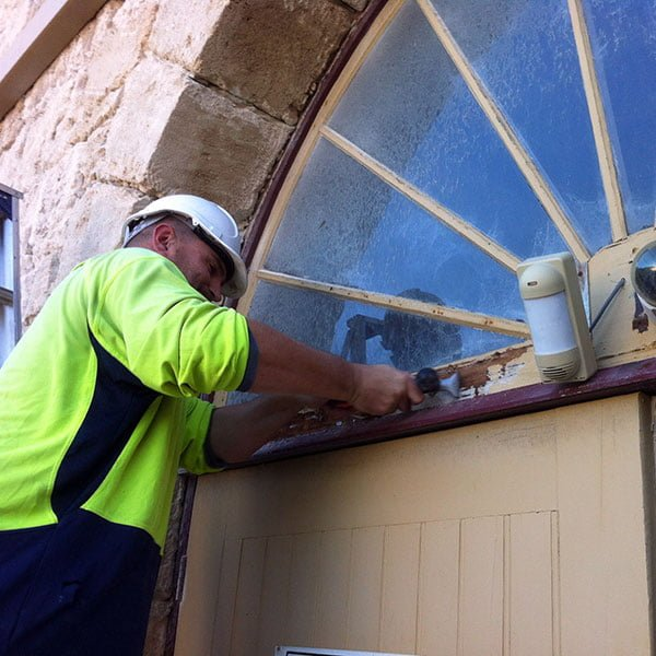 Restoring arched window on public building in Fremantle WA.