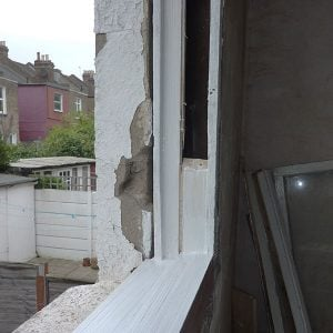 Repaired window sill with hardwood replacement.