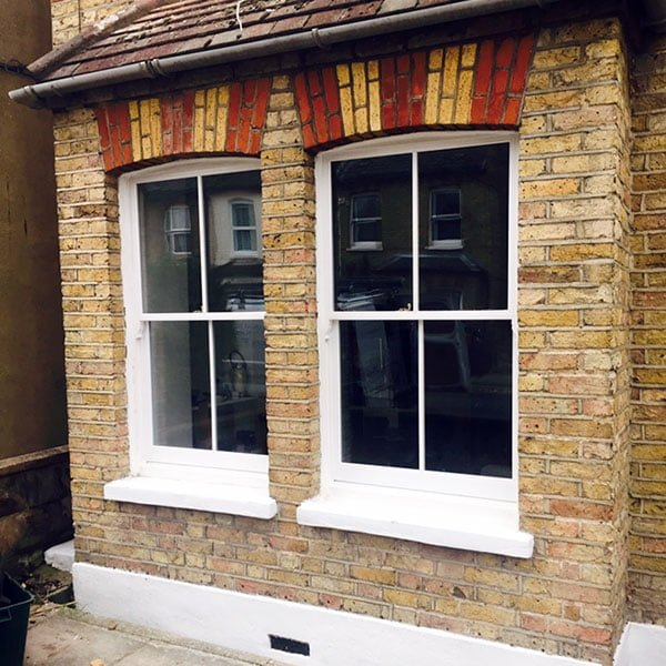 Casement reinstated to double hung sash window. - exterior