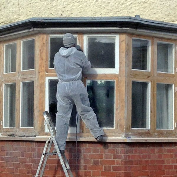 Paint stripping bay window.